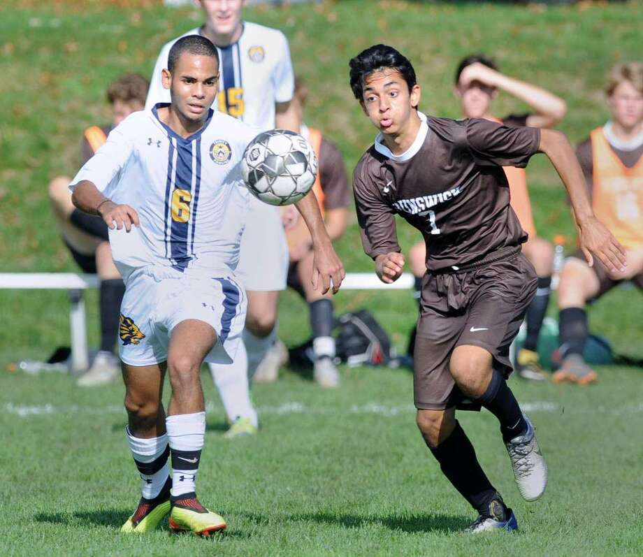 Aaryan Chinai, right, is a senior captain of the Brunswick School soccer team. Photo: Hearst Connecticut Media File Photo
