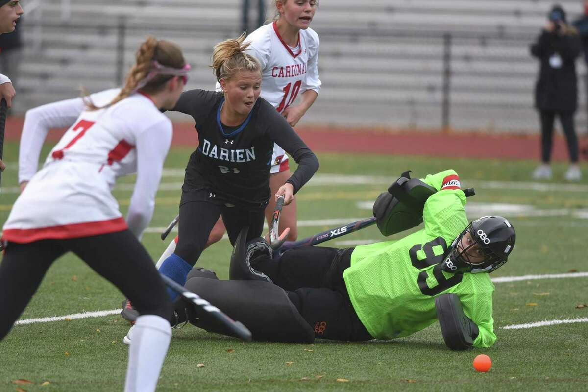 Greenwich goalie Jorja Pastore slides out to block a shot from Darien's Mully McGuckin during the Blue Wave's 2-0 victory on Friday in Greenwich.
