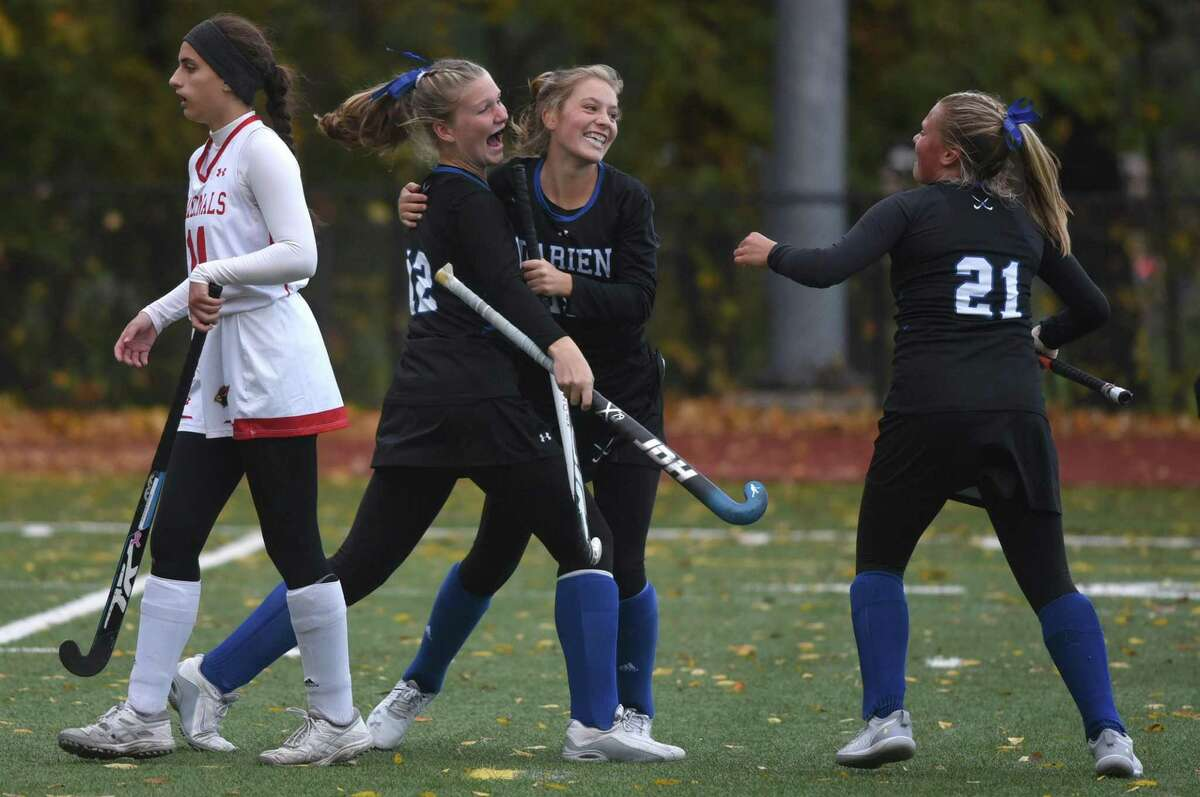 Darien's Sarah Bogdan (12), Ryan Hapgood and Molly McGuckin (21) celebrate a goal during the Blue Wave's 2-0 victory at Greenwich on Friday.