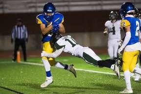 Midland's Zion Douglas scores a touchdown during a game against Alpena Friday, Oct. 30, 2020 at Midland Community Stadium. (Katy Kildee/kkildee@mdn.net)