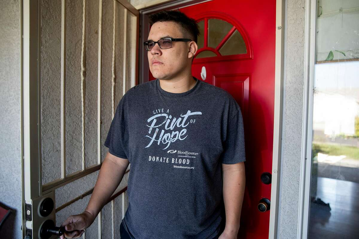 Michael Alexander poses for a portrait in the doorway of his mother's partner's home in Marysville, Calif. Thursday, October 29, 2020. Alexander was accused of murdering his neighbor Leola Shreves in 2013 and served over three years in prison, but DNA evidence revealed Armando Cuadras as the suspect, leading to his release in 2019. A new trial has begun for the new suspect Armando Cuadras. But, shockingly, the prosecution has told jurors they believe Cuadras and Michael Alexander killed Leola Shreves together, despite all the evidence pointing to Cuadras.