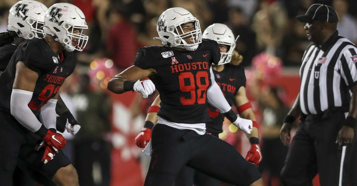 Houston Cougars defensive lineman Payton Turner (98) celebrates after sacking Southern Methodist Mustangs quarterback Shane Buechele (7) during the first quarter of an NCAA football game at TDECU Stadium on Thursday, Oct. 24, 2019, in Houston.