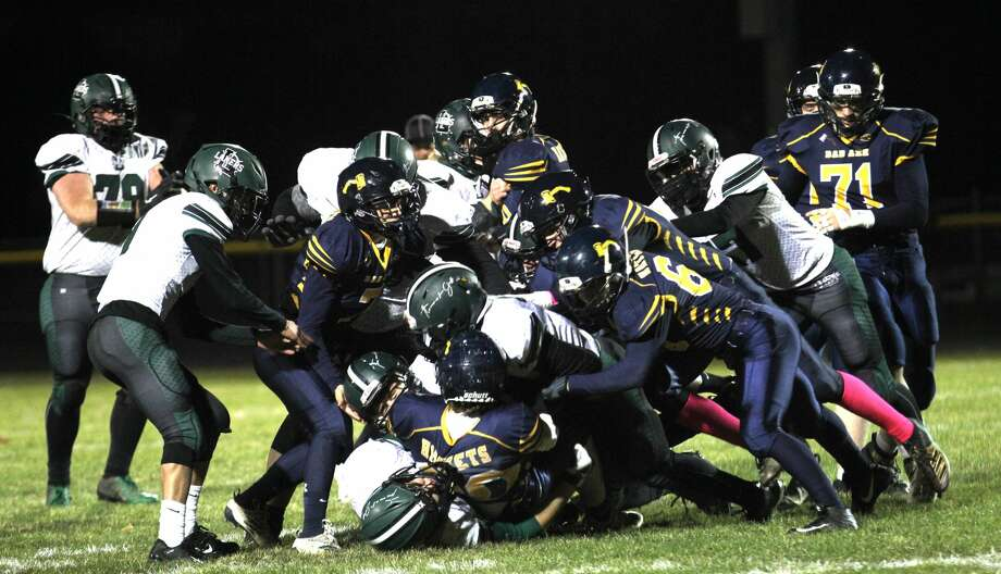 The Laker offense line battles the Bad Axe defense on the goal line in the second quarter Friday night.
