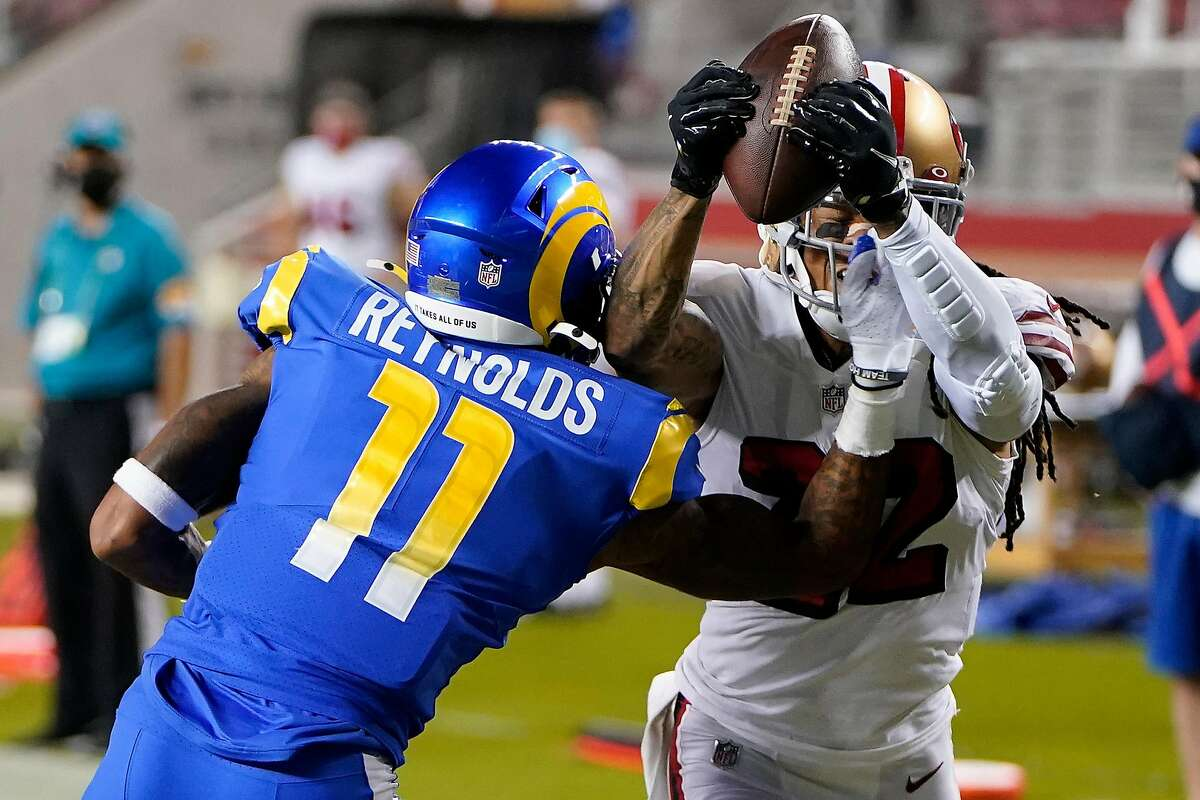 Cornerback Jason Verrett (right) intercepts a pass intended for Josh Reynolds in the 49ers' victory over the Rams.