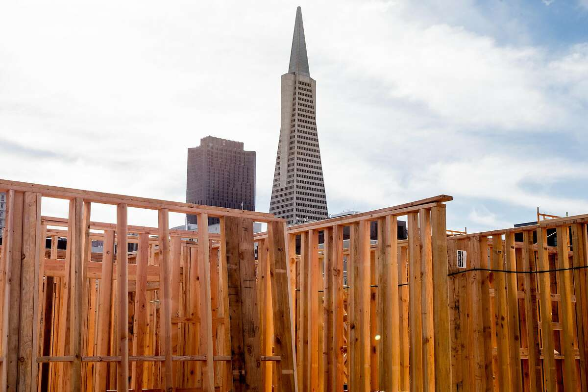 The Transamerica Pyramid, seen behind construction on nearby housing developments in February, was sold this year. San Francisco collects transfer tax on such deals.