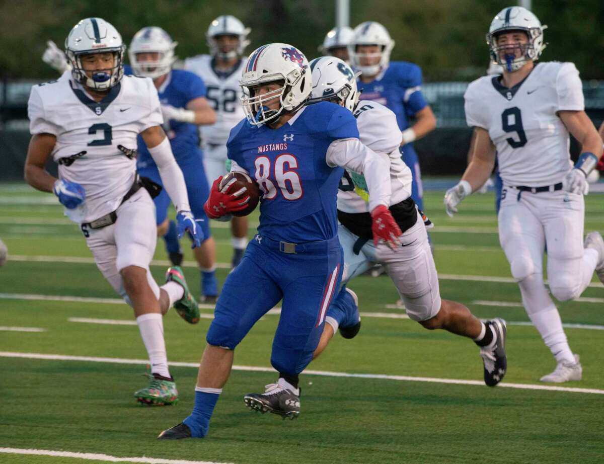 Midland Christian's Josh Keating looks for more yards after getting past the All Saints' defenders 10/30/2020 at Gordon Awtry Field. Tim Fischer/Reporter-Telegram