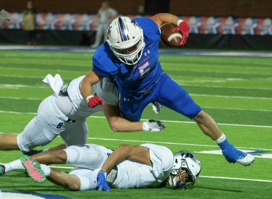 Midland Christian's Brad Evans gets tripped up by All Saints' Tony Lacy and Cavin Chumley 10/30/2020 at Gordon Awtry Field. Tim Fischer/Reporter-Telegram Photo: Tim Fischer, Midland Reporter-Telegram
