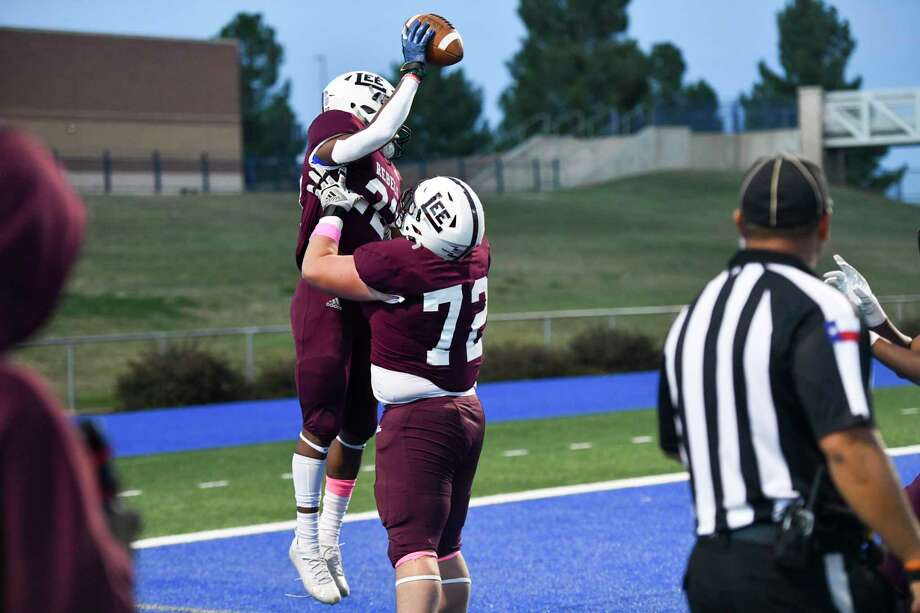 Lee's Makhilyn Young (22) celebrates with Seth Heller (72) after Young's touchdown Friday, Oct. 30, 2020 at Grande Communications Stadium. Jacy Lewis/Reporter-Telegram Photo: Jacy Lewis/Reporter-Telegram