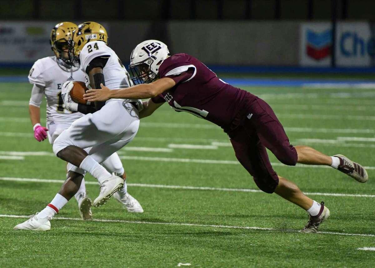 Lee's Koby Haas tackles Abilene High's Jeshari Houston (24) on Friday, October 30, 2020 at Grande Communications Stadium. Jacy Lewis/Reporter-Telegram