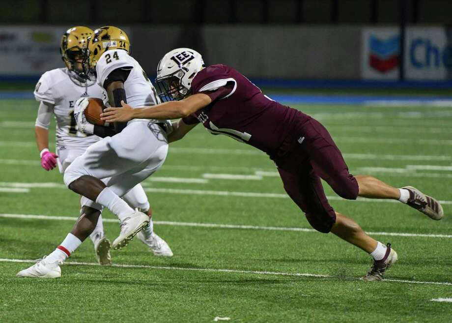 Lee's Koby Haas tackles Abilene High's Jeshari Houston (24) on Friday, October 30, 2020 at Grande Communications Stadium. Jacy Lewis/Reporter-Telegram Photo: Jacy Lewis/Reporter-Telegram