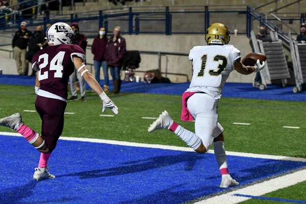 Abilene High's Anthony Ramirez (13) misses a reception as Lee's Finely Higgins (24) tails Ramirez in the end zone Friday, October 30, 2020 at Grande Communications Stadium. Jacy Lewis/Reporter-Telegram