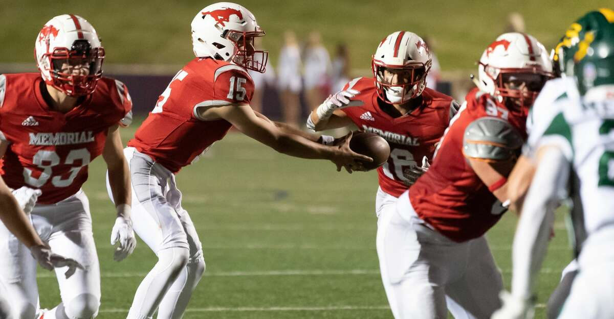 Chase Googwin (15) hands off to Carson Zahn (16) of the Memorial Mustangs in the first half against the Stratford Spartans during a High School football game on Friday, October 30, 2020 at Tully Stadium in Houston Texas.