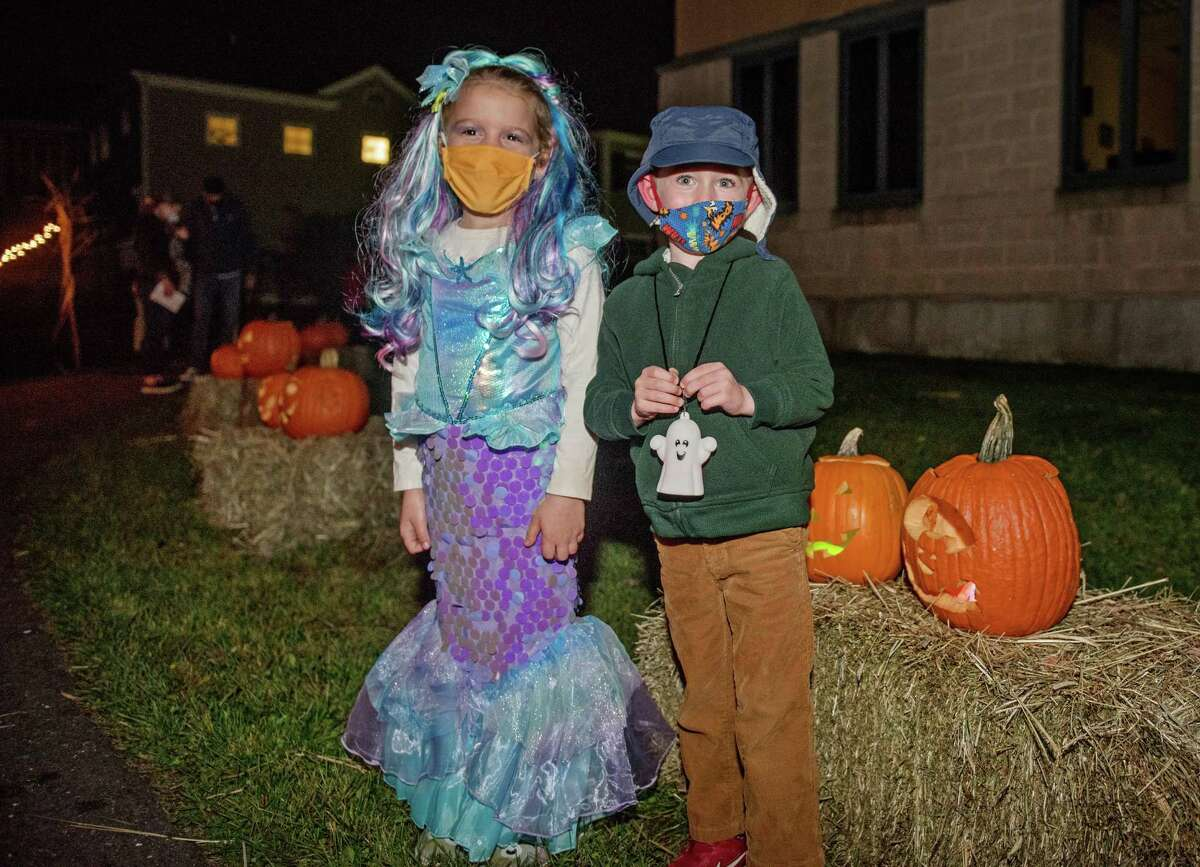 Children can still enjoy dressing up for Halloween, like these two who attended last weekend's Pumpkin Glow Stroll, but First Selectman Rudy Marconi is discouraging house to house to trick-or-treating or Halloween parties.