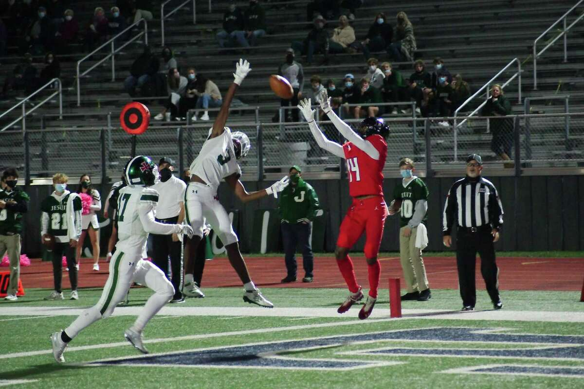 Dawson's Raynard Allen (14) pulls down a pass over Strake Jesuit's Craig Royal (3) for a touchdown Friday, Oct. 30 at The Rig.