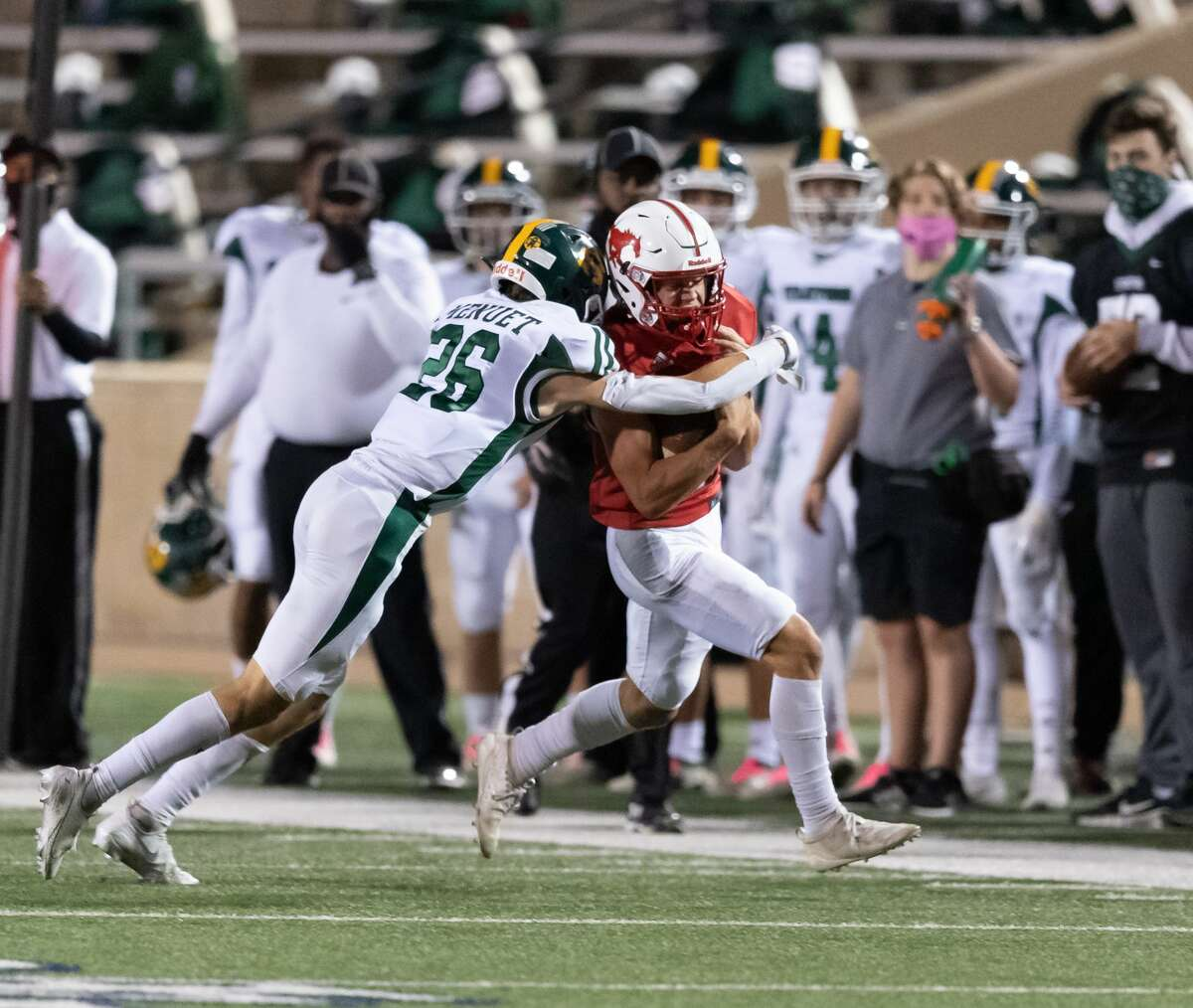 Christian Braddock (6) of the Memorial Mustangs is brought down in the first half by Brecken Menuet (26) of the Stratford Spartans during a High School football game on Friday, October 30, 2020 at Tully Stadium in Houston Texas.
