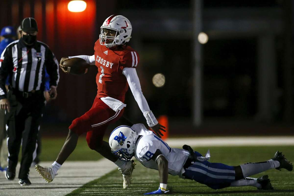 Barbers Hill Eagles Theron Pierre (18) tackles Crosby Cougars Reggie Branch (1) in the first half during the first half of the high school football game between the Crosby Cougars and the Barbers Hill Eagles at Cougar Stadium in Crosby, TX on Friday, October 30, 2020. The Cougars lead the Eagles 20-7 at halftime.