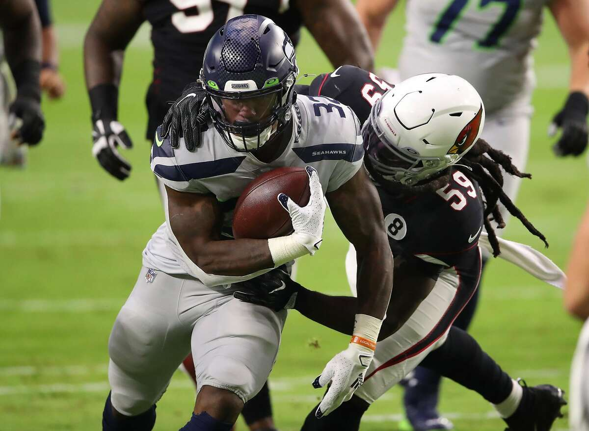 Chris Carson (32) and two other Seahawks running backs were hurt last Sunday against the Cardinals.