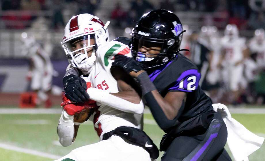 The Woodlands wide receiver Teddy Knox (2) gets tackled near the end zone by Willis athlete Derek Lagway (12) during the third quarter of a district 13-6A football game at Berton A. Yates Stadium in Willis, Friday, Oct. 30, 2020. Photo: Gustavo Huerta, Houston Chronicle / Staff Photographer / 2020 © Houston Chronicle