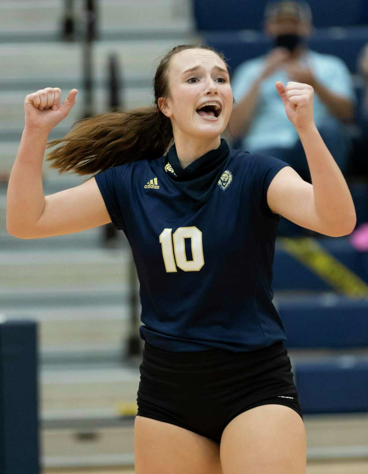 Lake Creek setter Lauren Greene (10) cheers after their team wins the first set of a District 20-5A volleyball match at Lake Creek High School against Porter in Montgomery, Tuesday, Oct. 13, 2020.