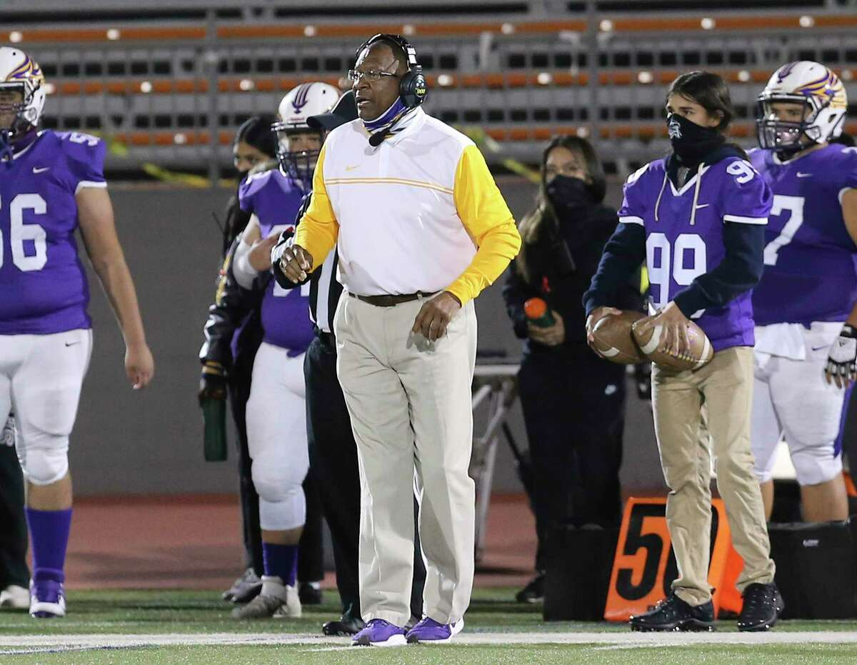 Brackenridge football coach Willie Hall (center) directs his team against Sam Houston during their football game at Alamo Stadium on Friday, Oct. 30, 2020.