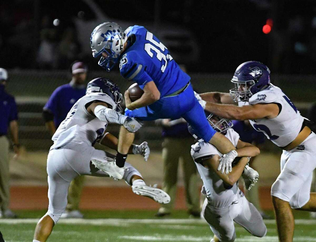 Running back Hunter Kitzmiller of La Vernia (35) attempts to escape a trio of Boerne defenders during high school football action at Bear Stadium in La Vernia on Friday, Oct. 30, 2020.