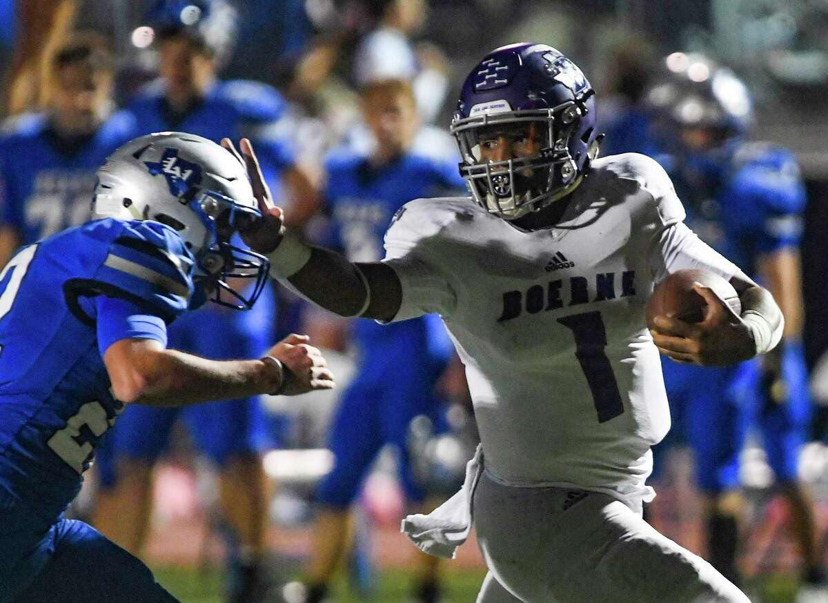 Boerne quarterback Rashawn Galloway stiff arms La Vernia defender Hunter Stautzenberger enroute to a touchdown during high school football action at Bear Stadium in La Vernia on Friday, Oct. 30, 2020.