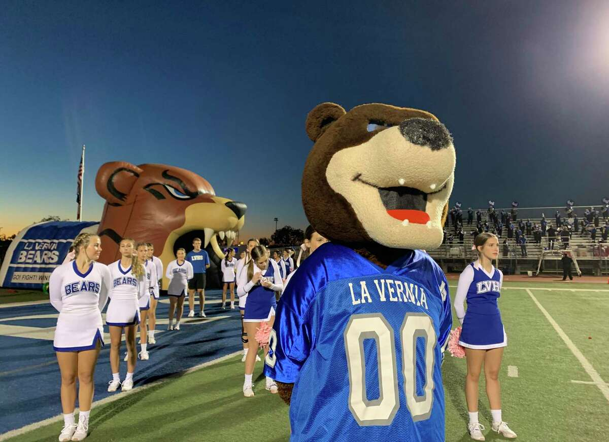 The La Vernia Bears mascot joins cheerleaders on the field before the start of the school's game against Boerne at Bear Stadium in La Vernia on Friday, Oct. 30, 2020.