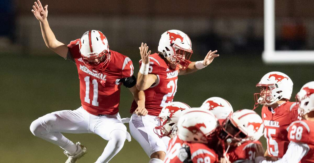 Mason Sanders (11) of the Memorial Mustangs celebrates their win over the Stratford Spartans with Bradley Baay (25) during a High School football game on Friday, October 30, 2020 at Tully Stadium in Houston Texas.