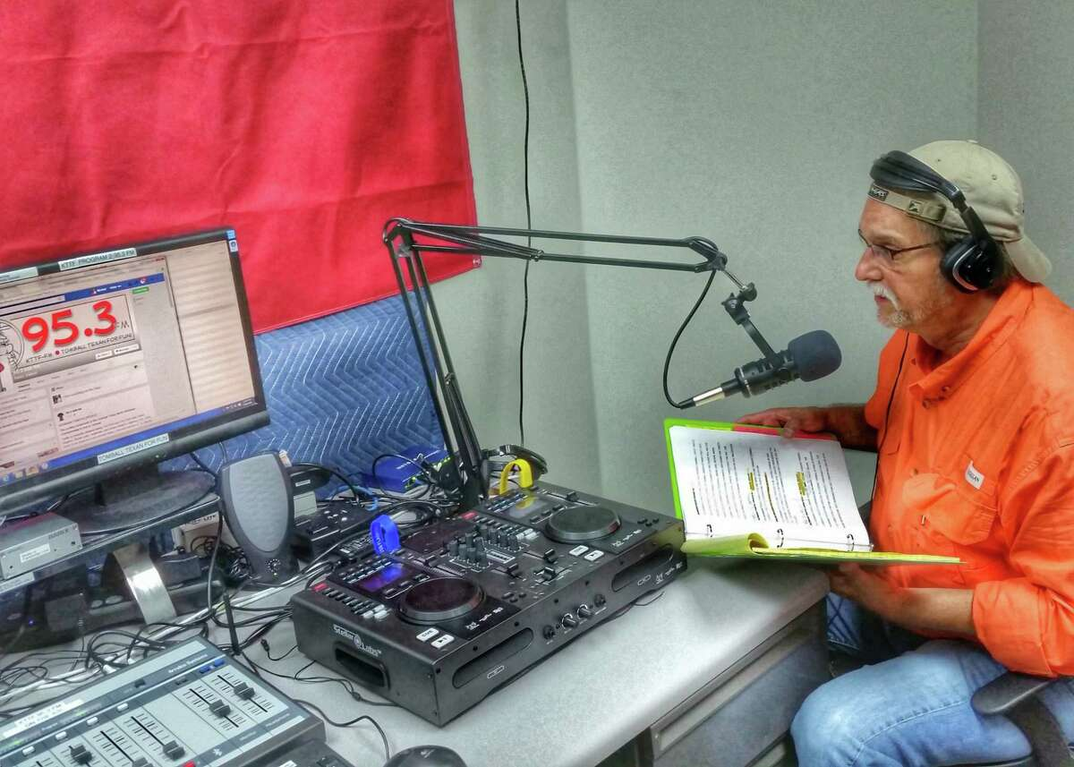 Mike Baxter, Tomball's director of marketing and tourism, sits in the KTTF 95.3 FM radio station studio in Tomball Fire Station 1.
