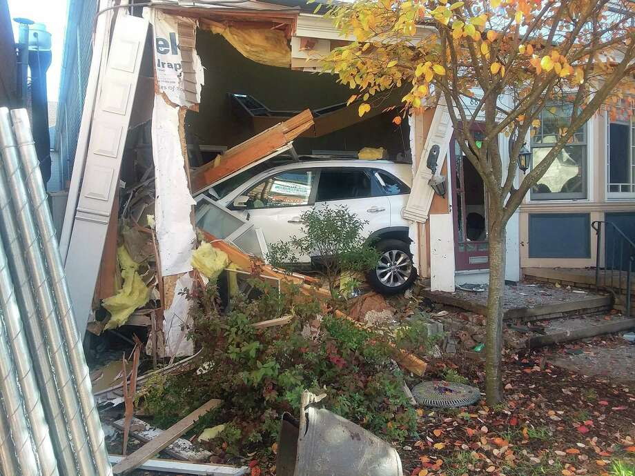 A 20-year-old Portland man was arrested after the vehicle he was driving crashed into the Westville Dental building on Whalley Avenue early Saturday morning, on Oct. 30, 2020, police said. At 2:08 a.m., police responded to a security alarm at 881 Whalley Ave. The driver, who was found in the basement, was charged driving under the influence of alcohol or drugs. Photo: Helen Bennett /Hearst Connecticut Media