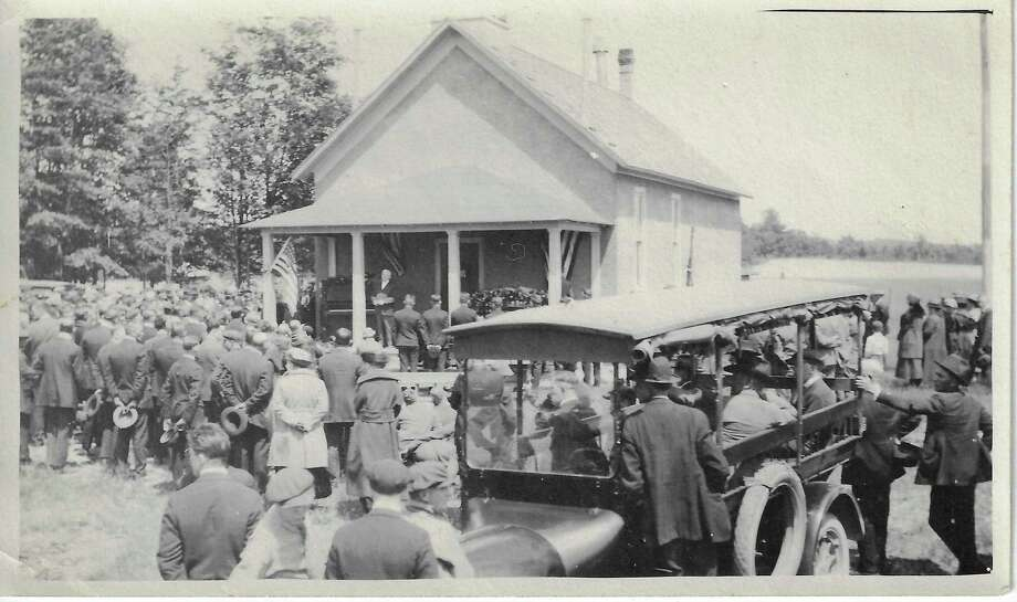 The funeral of John Mortenson at the Frederickson schoolhouse in Blaine Township. He died on Nov. 20, 1918 of wounds he received in combat during WWI. The American Legion post in Frankfort is named after him.(Courtesy Photo)