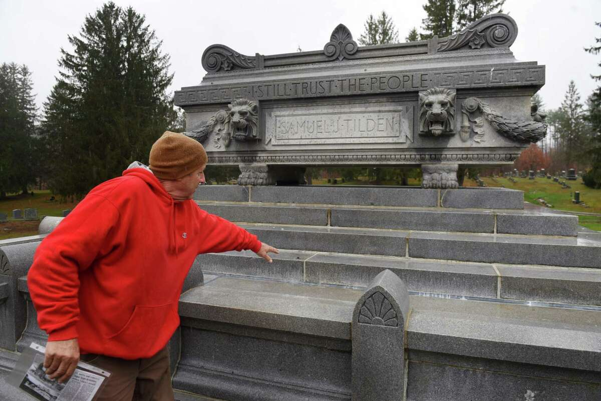 Ed Godfroy, cemetery superintendent at Cemetery of the Evergreens, points to where a bronze wreath was taken from the grave of former New York governor Samuel J. Tilden on Thursday, Oct. 29, 2020, at Cemetery of the Evergreens in New Lebanon, N.Y. Tilden was the Democratic candidate for president in 1876. He lost to Rutherford B. Hayes in a contested election. (Will Waldron/Times Union)