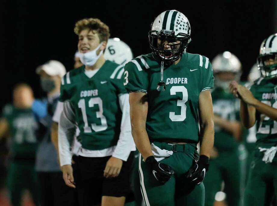 In this file photo, John Cooper outside linebacker Jake Peterson (3) reacts after a touchdown. The Dragons shut out a third-straight opponent Friday night to improve to 5-0. Photo: Jason Fochtman, Houston Chronicle / Staff Photographer / 2020 © Houston Chronicle