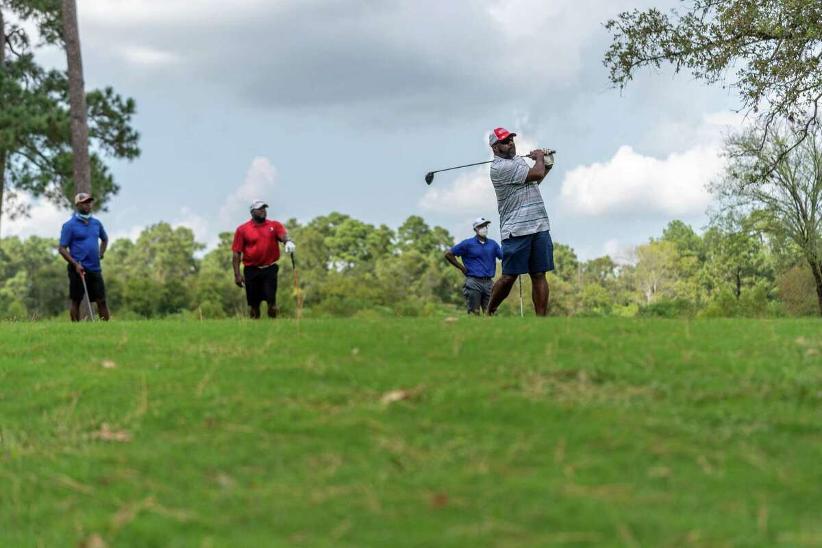 Spring ISD Police Chief Kenneth Culbreath (far right) plays a round of golf during the