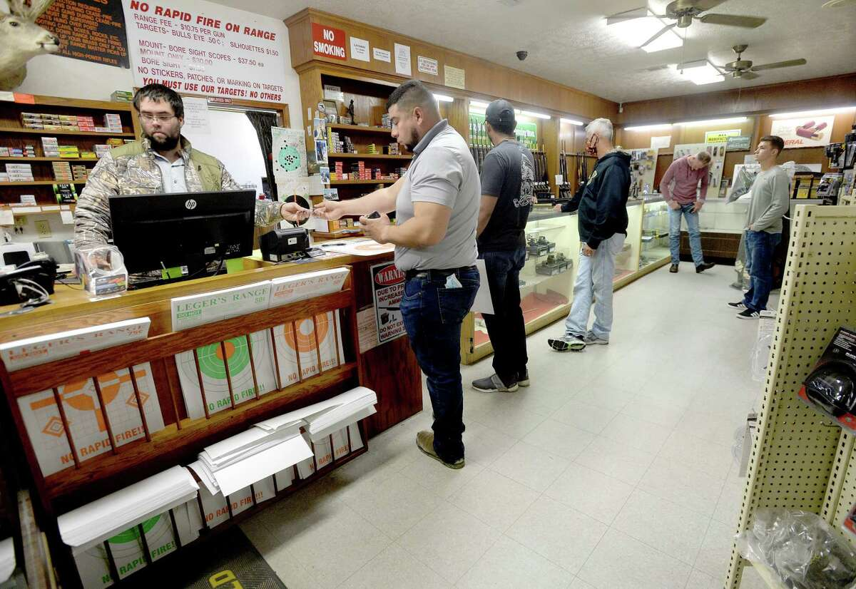 Shoppers line up for ammunition and range time purchases at Leger's Shooting Range Wednesday. Owner Randy Leger has had to limit boxed ammo sales and the normally stocked shelves are sparse as a shortage of guns and ammunition due to COVID-19 production upset and soaring demand amid the pandemic and national unrest. Photo taken Wednesday, October 28, 2020 Kim Brent/The Enterprise