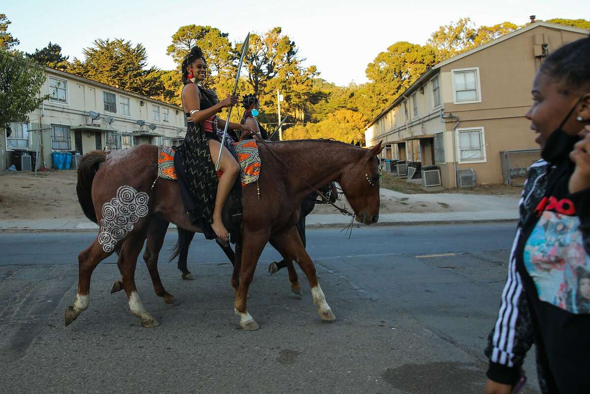 Brianna Noble (left) her friend Dale Johnson, and Noble's sister, Brittany Lewis, ride their horses through the Sunnydale neighborhood clad in their