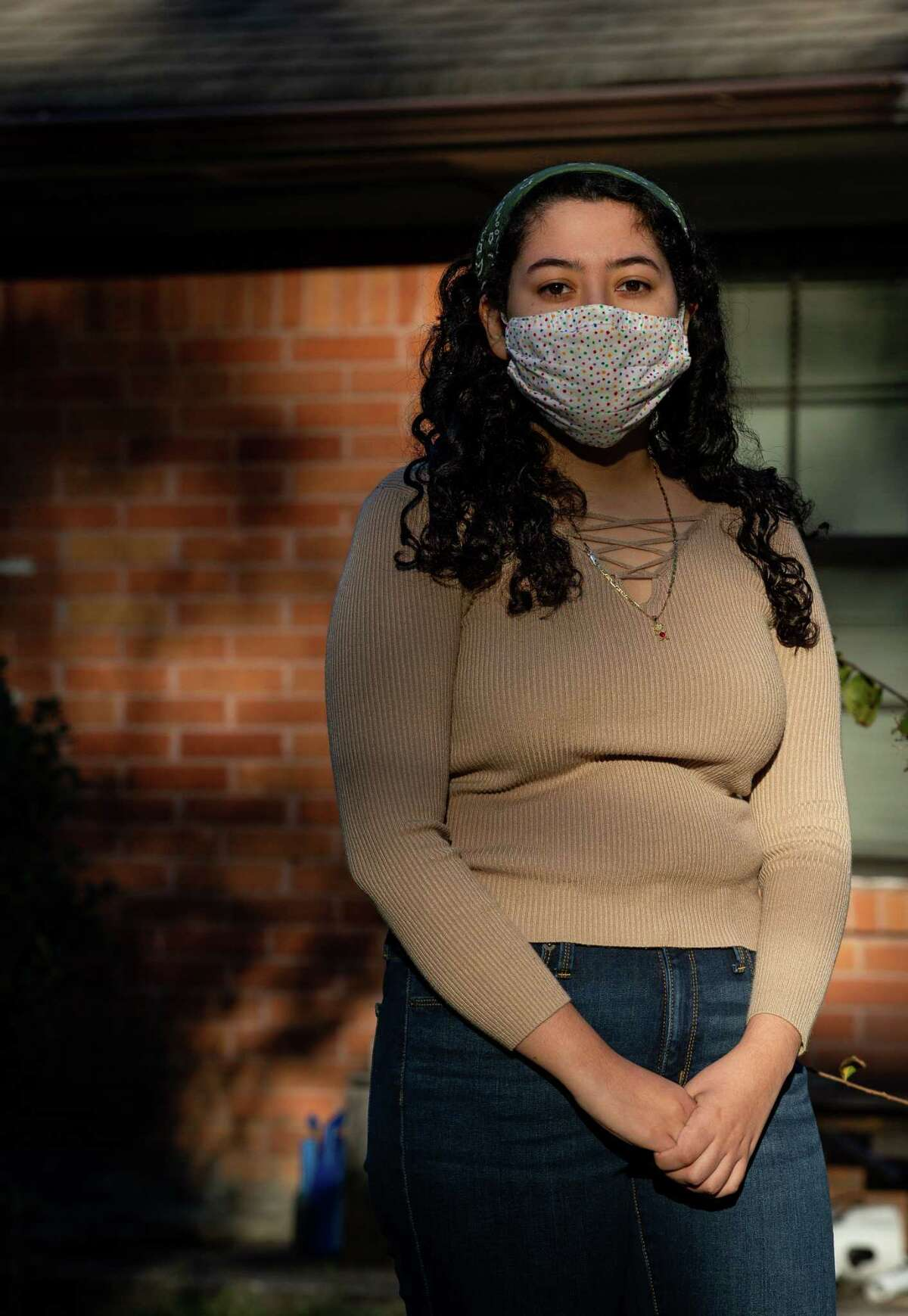 Michelle Ramirez, 18, who voted for the first time, poses for a photograph at her house Friday, Oct. 30, 2020, in Houston. Young voters are turning out in big numbers to help Latinos capture their largest-ever share of the Harris County electorate.
