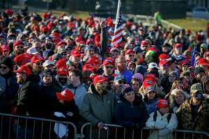 Supporters wait outside the airport before President Donald Trump speaks at a campaign rally Friday, Oct. 30, 2020, in Rochester, Minn.