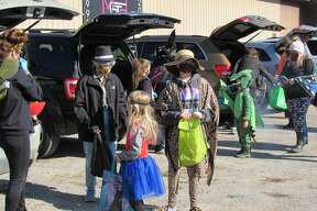 Trick-or-treaters got a head start on Halloween fun Saturday afternoon at Midland Gymnastics Center and Baseball Heaven's Trunk-or-Treat event.