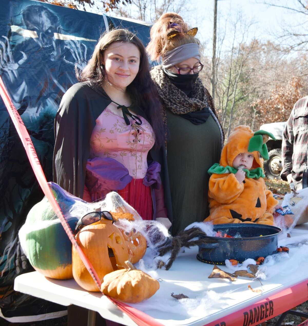 (From left) Harmony Silvey, Lindsay Riker and the 1-year-old Lincoln Pruett were donning costumes and jamming to Rob Zombie's