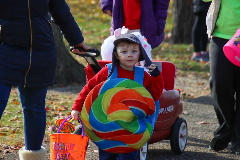 Dozens of families turned out to the Bad Axe Library's costume parade Oct. 31. Photo: Scott Nunn/Huron Daily Tribune