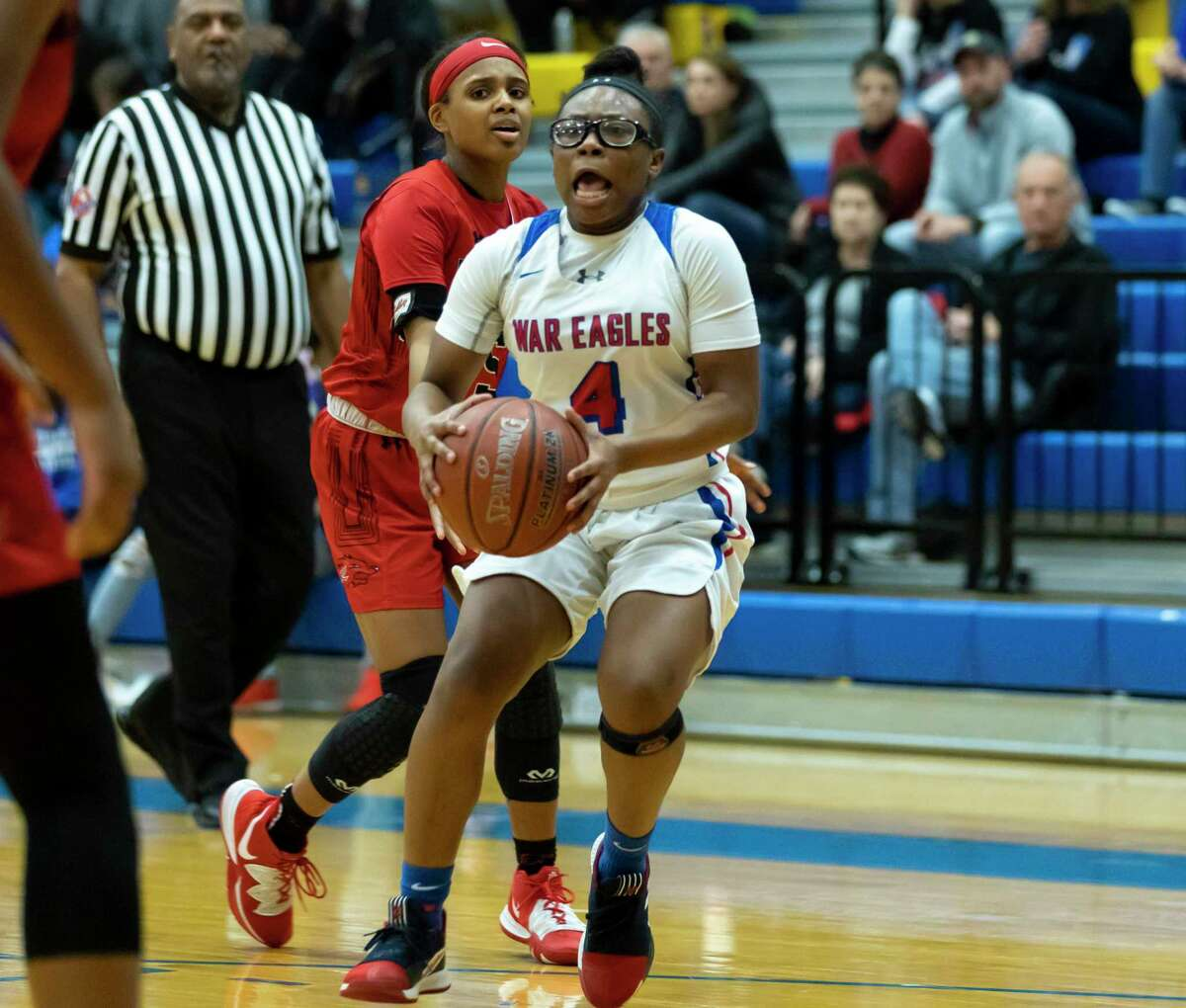 Oak Ridge guard Malade Hollis (4) is expected to move from an off-the-bench to starting role this season.