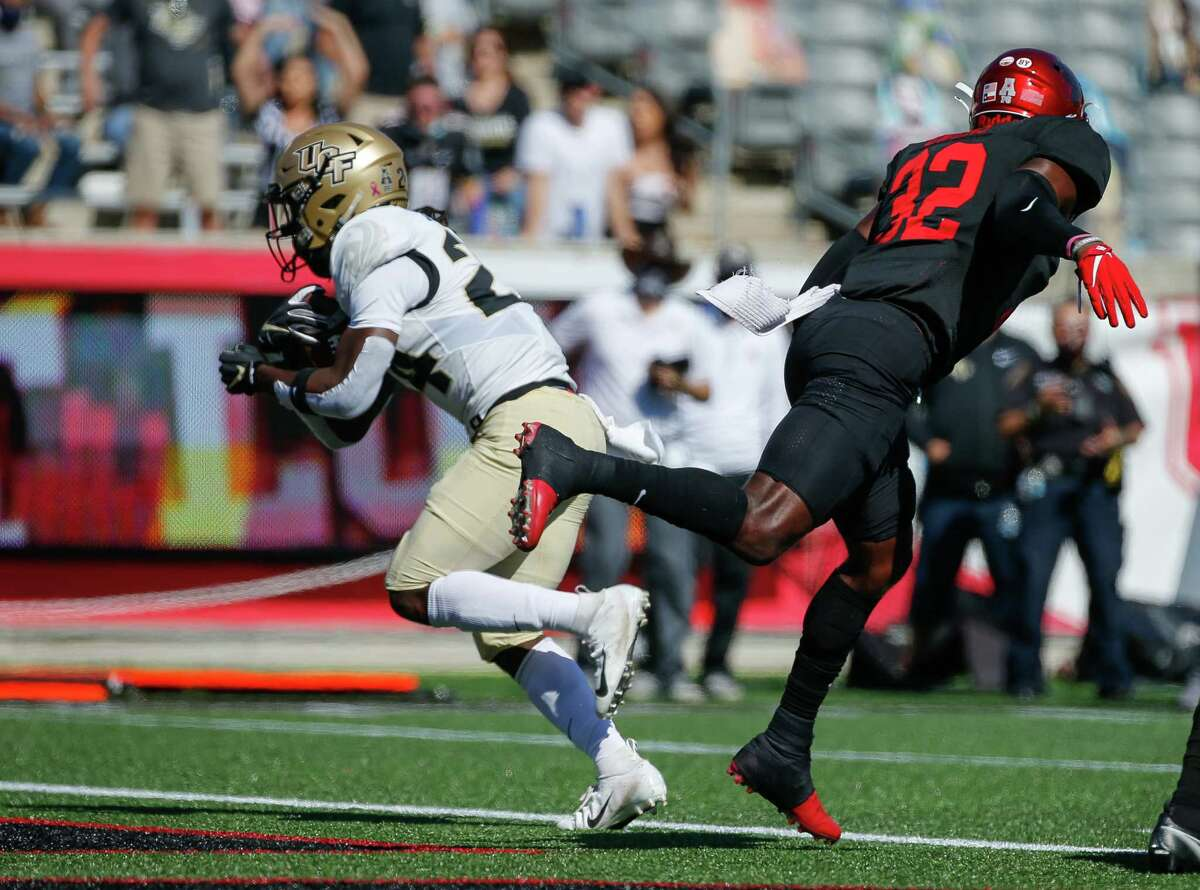 UCF Knights running back Bentavious Thompson (24) scores a rushing touchdown against the Houston Cougars during the second quarter of an NCAA football game at TDECU Stadium on Saturday, Oct. 31, 2020, in Houston.