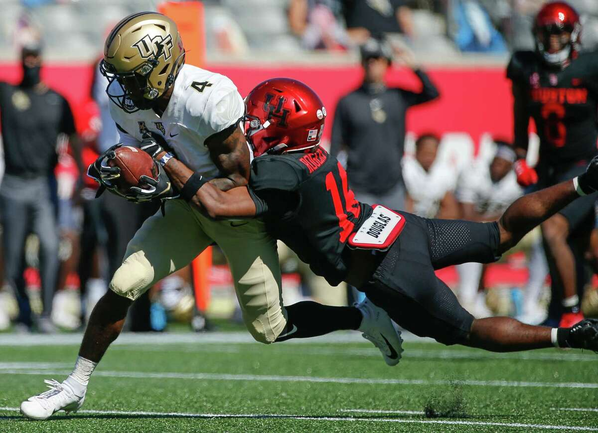 Houston Cougars cornerback Jayce Rogers (16) tackles UCF Knights wide receiver Ryan O'Keefe (4) during the second quarter of an NCAA football game at TDECU Stadium on Saturday, Oct. 31, 2020, in Houston.