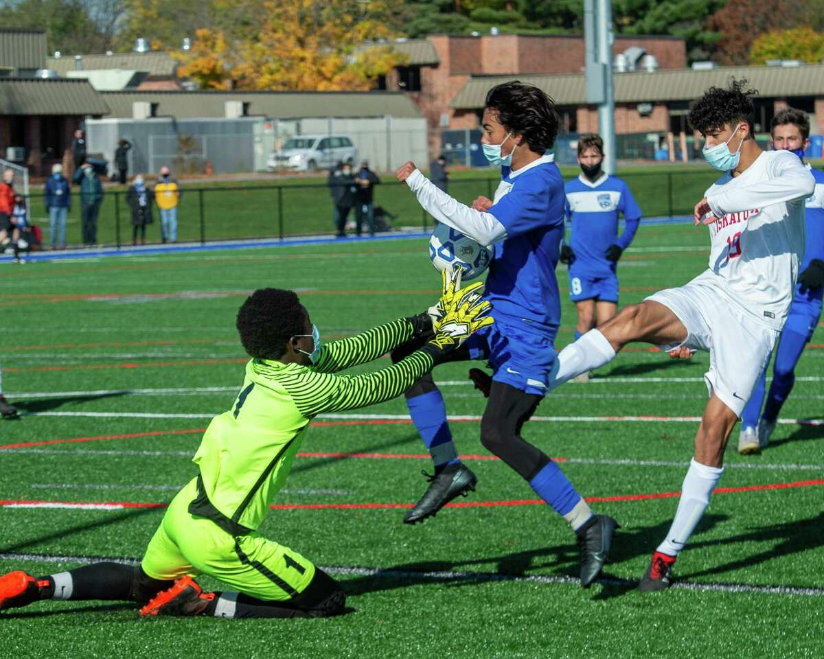 Niskayuna keeper Papa Ndiaye gets in front of Saratoga sophomore Nicholas Varghese (blue) during a Suburban Council soccer matchup against Niskayuna at Saratoga High School in Saratoga, NY, on Saturday, Oct. 31, 2020 (Jim Franco/special to the Times Union.)