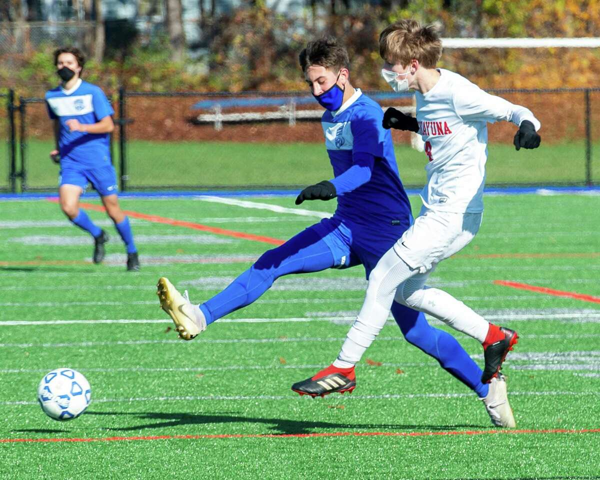 Niskayuna senior Dan Somoza (white) and Saratoga senior Jack Donnelly (blue) battle for position during a Suburban Council soccer matchup against Niskayuna at Saratoga High School in Saratoga, NY, on Saturday, Oct. 31, 2020 (Jim Franco/special to the Times Union.)