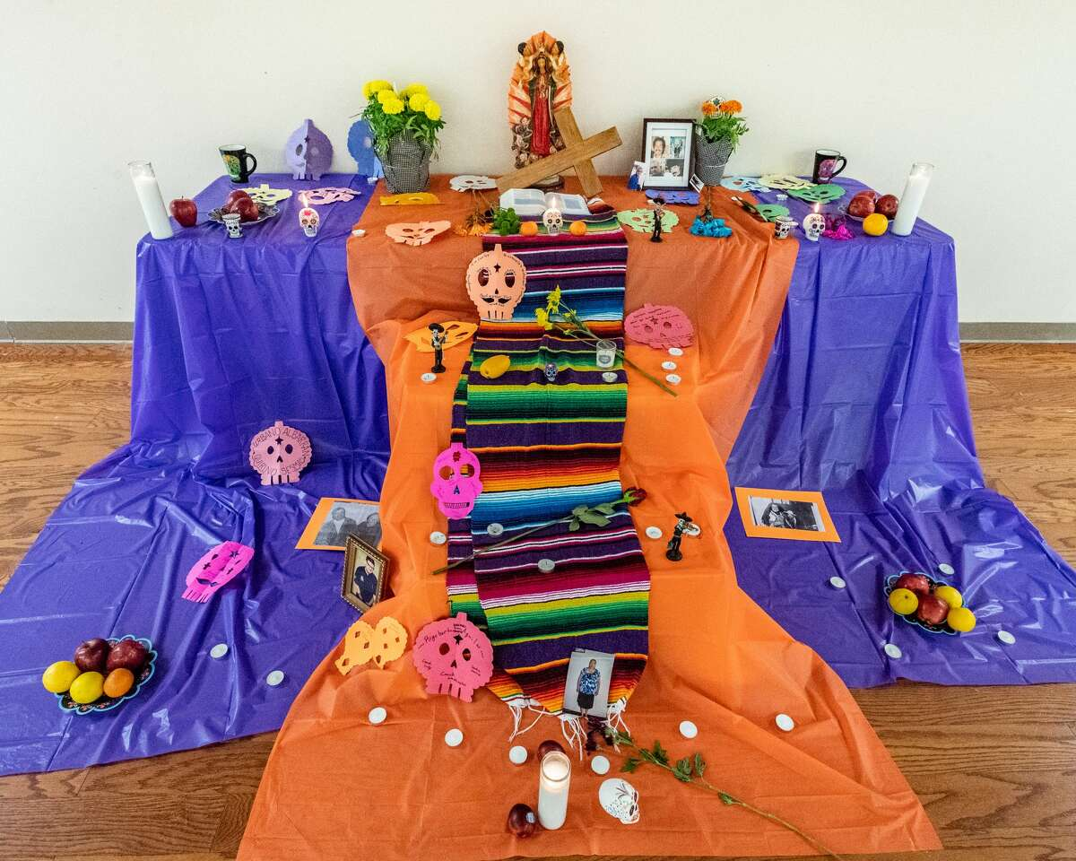The Ofrenda constructed at Cristo Rey for the celebration of Día de los Muertos is in the parish hall. The ofrenda is a temporary altar built to welcome the spirits still on the journey of life. It is built to incorporate the elements of earth, water, fire and wind to lead the sprits to the altar to help them along the way. Orange is a central color, and it is thought the colorful marigolds which represent the earth will help draw the spirits to the altar with their brilliant colors and scents. Water is placed on the altar for the spirits to refresh themselves on the journey. Día de los Muertos is a celebration of the lives of those who have come before. It is usually celebrated on November 2nd which is called All Souls Day in the Catholic Church. Photo made on October 30, 2020. Fran Ruchalski/The Enterprise