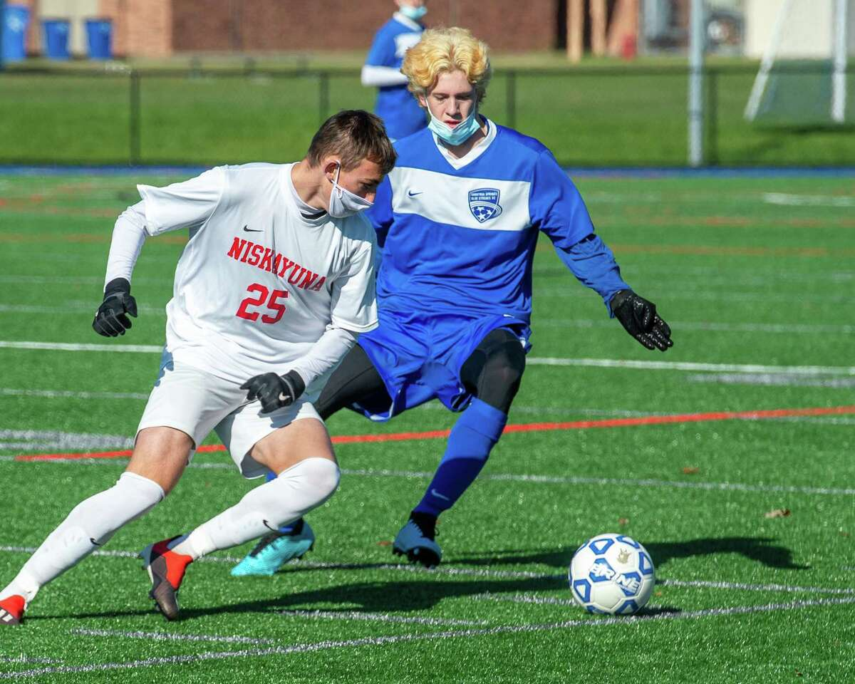 Niskayuna junior Zachary Lind (white) challenges Saratoga senior James Bellanca (blue) during a Suburban Council soccer matchup against Niskayuna at Saratoga High School in Saratoga, NY, on Saturday, Oct. 31, 2020 (Jim Franco/special to the Times Union.)
