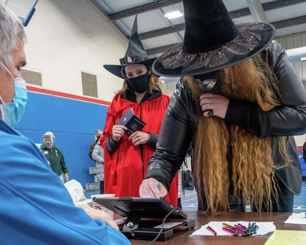 Molly Dunn (left) and Marcella Hammer dressed up as witches before casting ballots at Gavin Park in Saratoga, NY, on Halloween, Saturday, Oct. 31, 2020 (Jim Franco/special to the Times Union.)