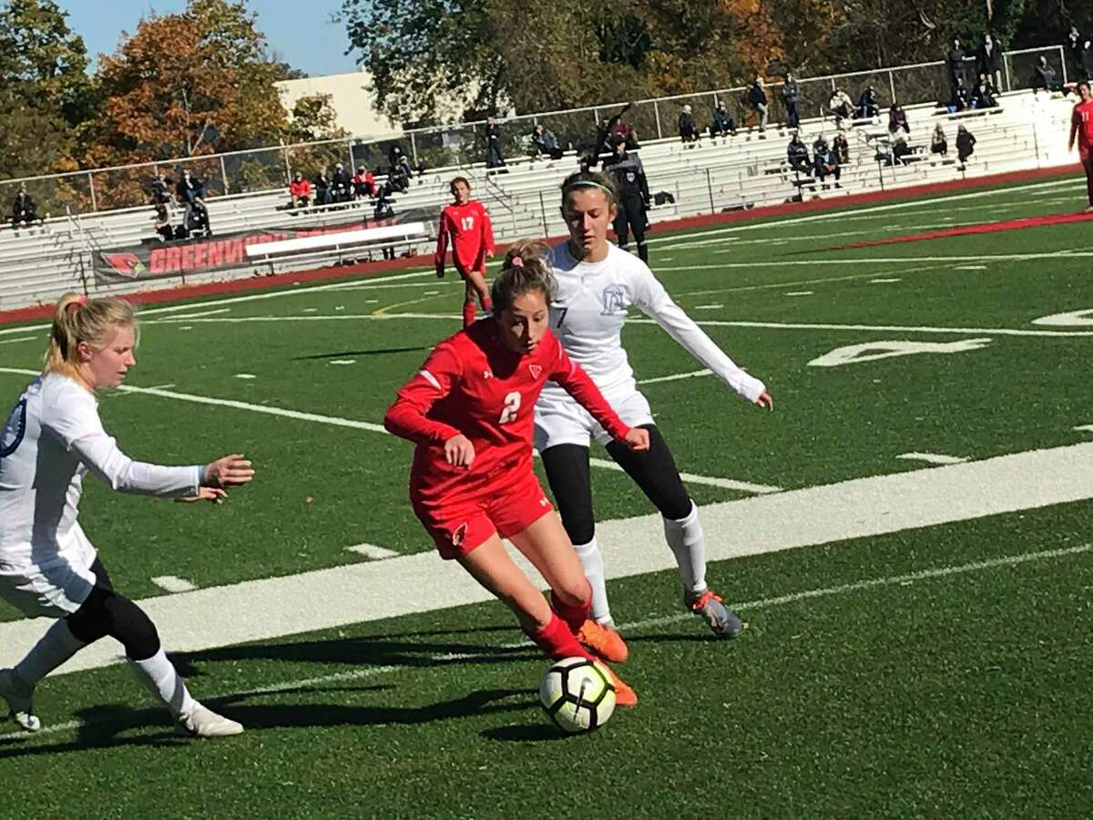 Greenwich's Sophia Bastek tries to move the ball up field during an FCIAC West Division soccer game against Darien on Saturday, October 31, 2020, in Greenwich, Connecticut.